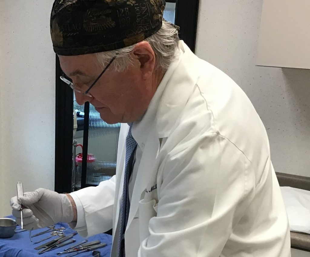 craig r dufresne md facs surgeon instruments in background